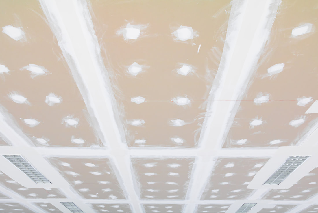 Installed gypsum boards on a ceiling